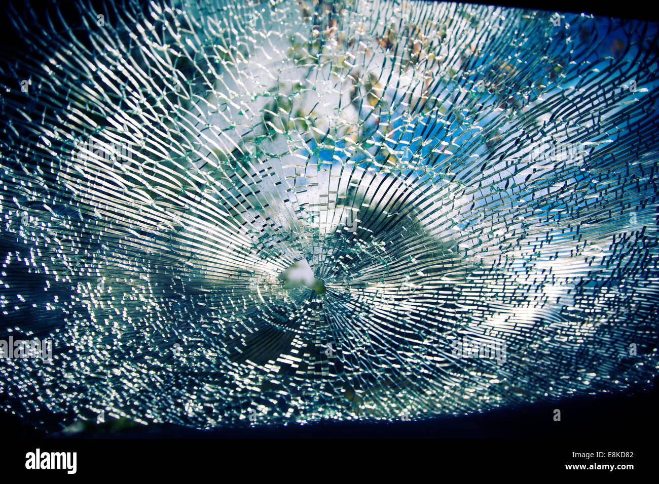 Looking out through a broken windshield during the daylight - Stock Image