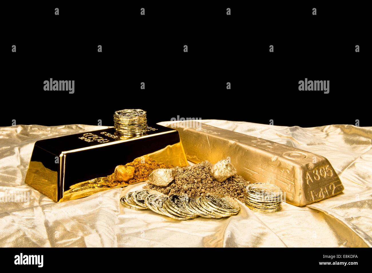 Gold in various forms including dust, nuggets, bar, ingot and coins isolated on a black background for placement - Stock Image
