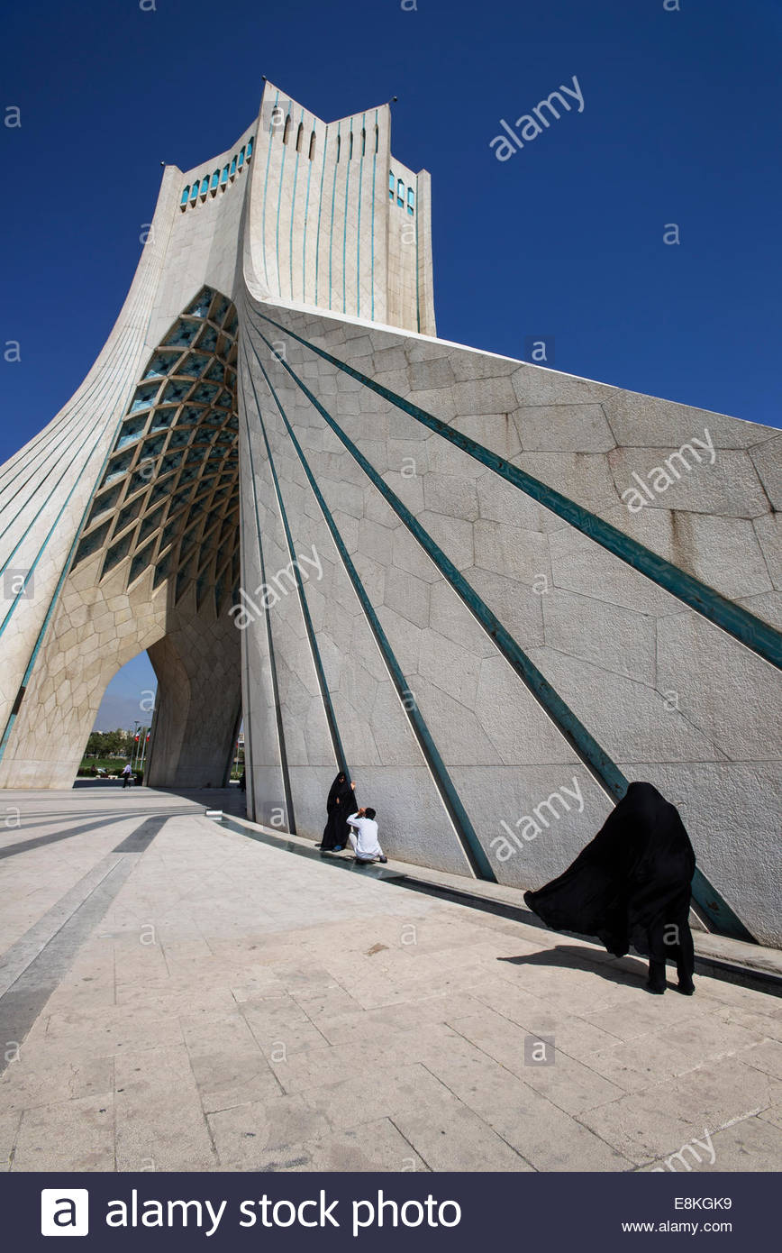 Muslims rest near Azadi tower, Tehran, Iran.  The Azadi or Liberty Tower is the symbol of Tehran and marks the west - Stock Image