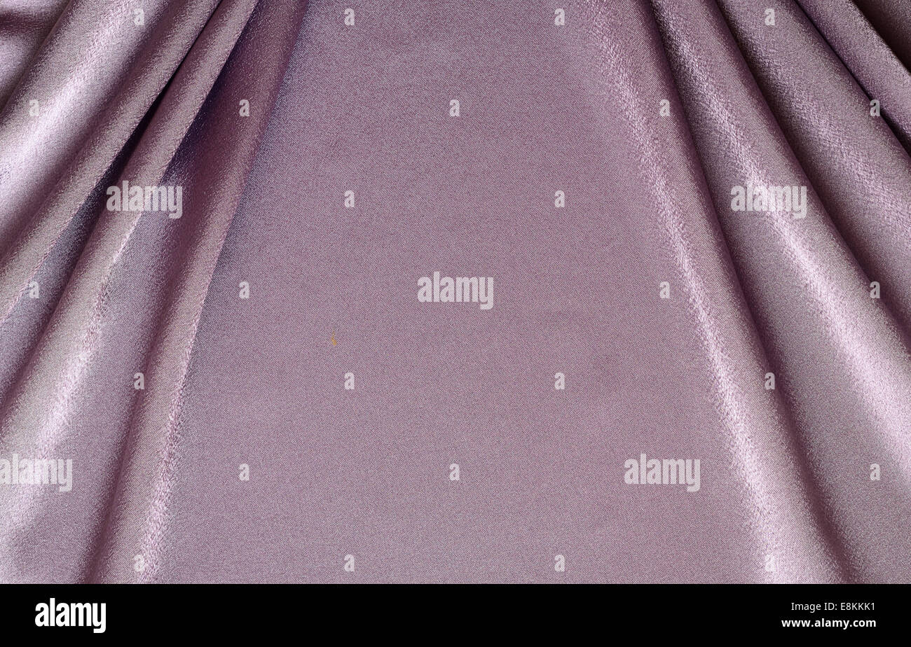 Lilac draped silk fabric for background - Stock Image