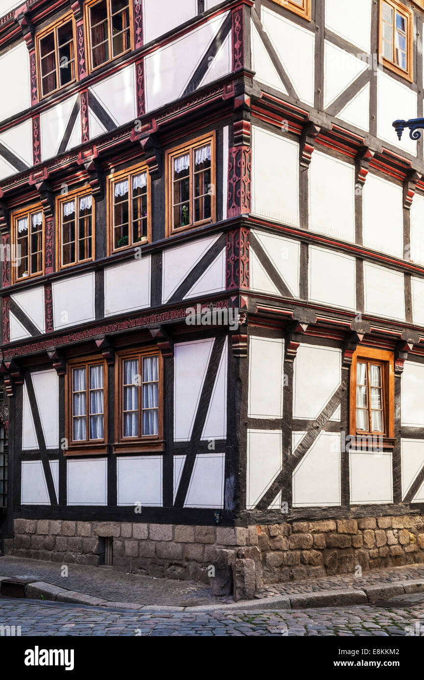 Corner of a half-timbered medieval house in the UNESCO World Heritage town of Quedlinburg, Germany. - Stock Image