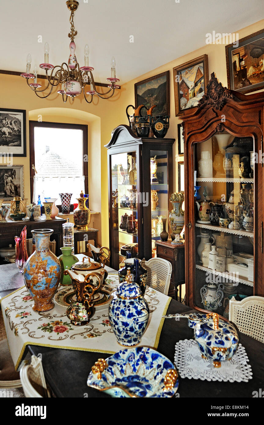 Old vases, glasses, and display cases in a private collection - Stock Image