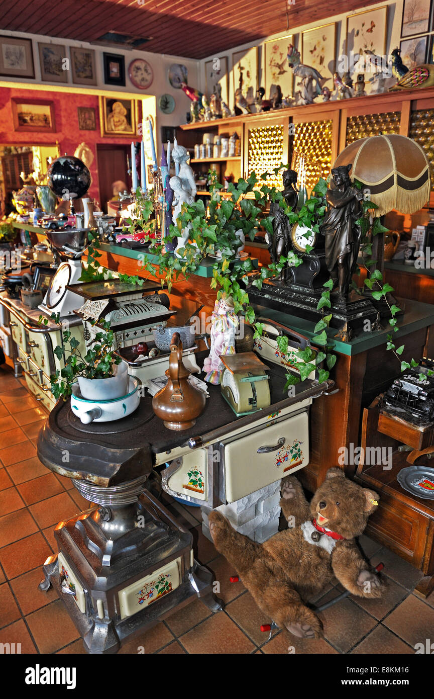 Various old stoves and knick-knacks in a private collection - Stock Image