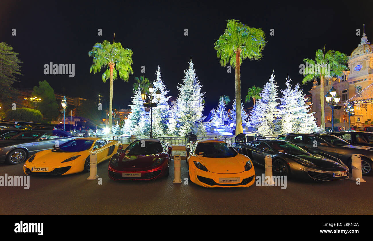 Christmas Sports Car.Four Mclaren Sports Car In Front Of Christmas Decoration