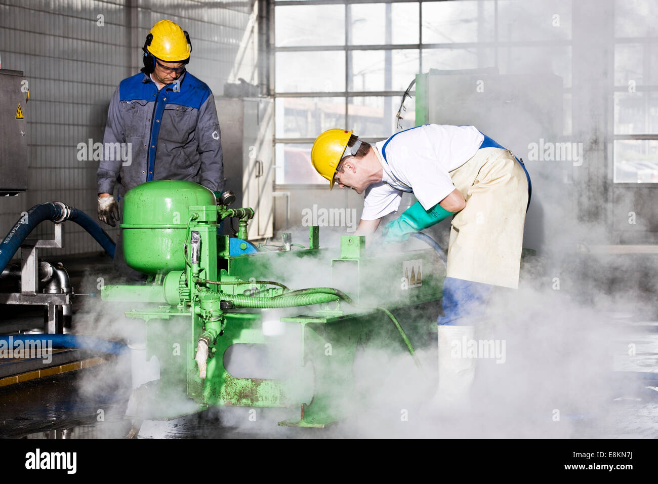 On-site service at GE Energy, gas engine to generate electricity is exchanged after reaching specified operating - Stock Image