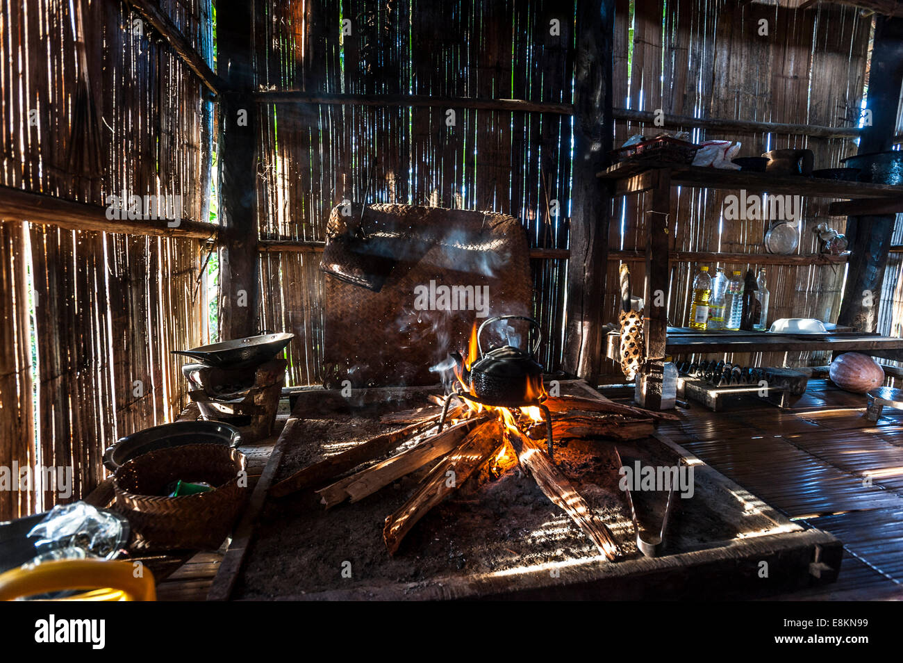 Kettle over an open fire in a kitchen made of bamboo, Lahu village, province of Mae Hong Song, Northern Thailand, - Stock Image