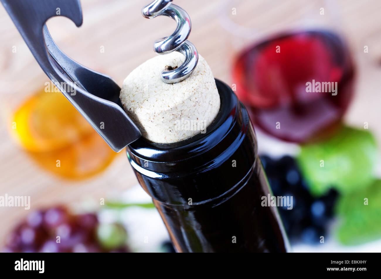 Corkscrew opening a bottle of wine Stock Photo