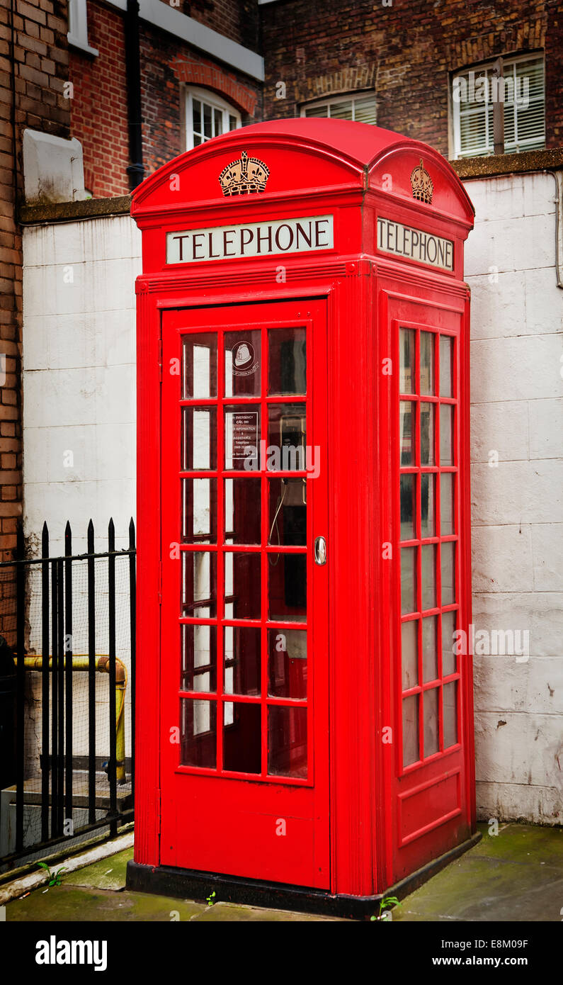 red telephone box in city of london - Stock Image