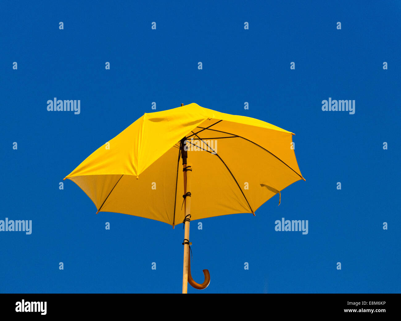 October 10 2014 Hong Kong  Yellow umbrella - Stock Image