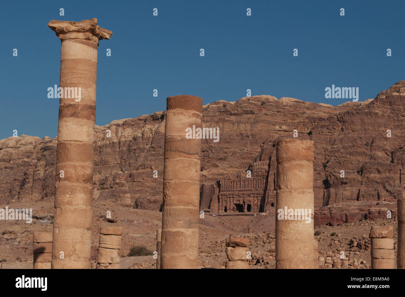 Petra: Kings Wall with the Royal Tombs, funerary structures carved int the rock face of the mountain seen through Stock Photo