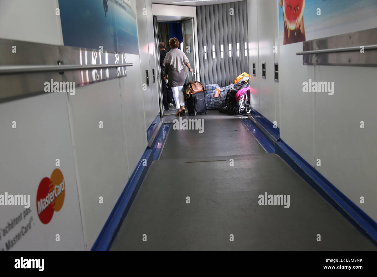 Athens Greece Athens International Airport Passengers Boarding Aeroplane Through A Docking Arm - Stock Image