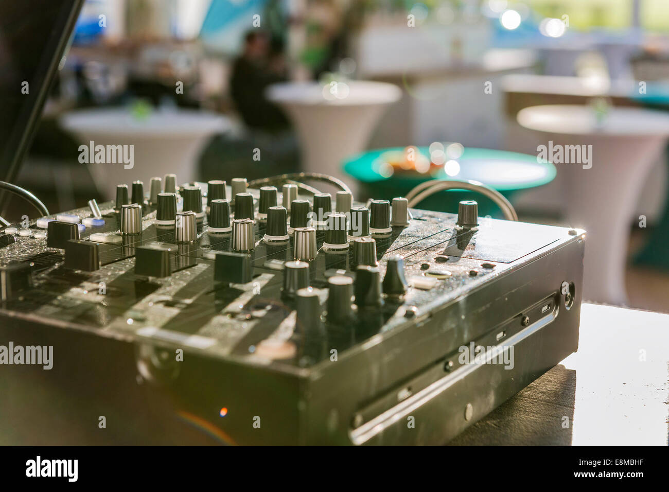 Image of a dusty mixer in the back light - Stock Image