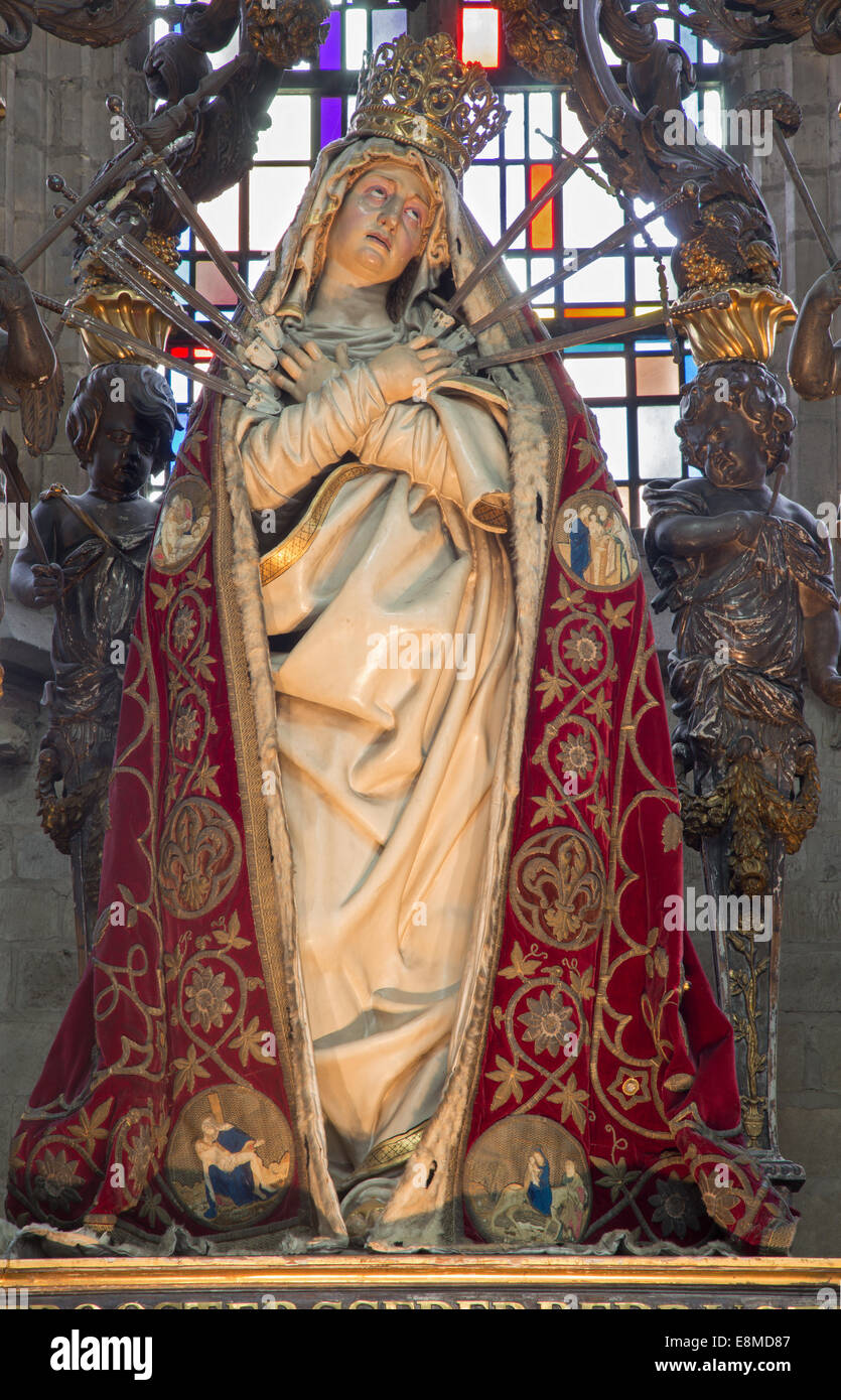 MECHELEN, BELGIUM - JUNE 14, 2014: The carved statue of the Lady of Sorrow in the coat in church Our Lady across - Stock Image