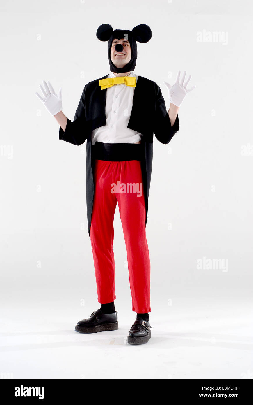 Man dressed in fancy dress comedy costume as mickey mouse disney character in a white studio with mickey mouse ears gloves  sc 1 st  Alamy & Man dressed in fancy dress comedy costume as mickey mouse disney ...