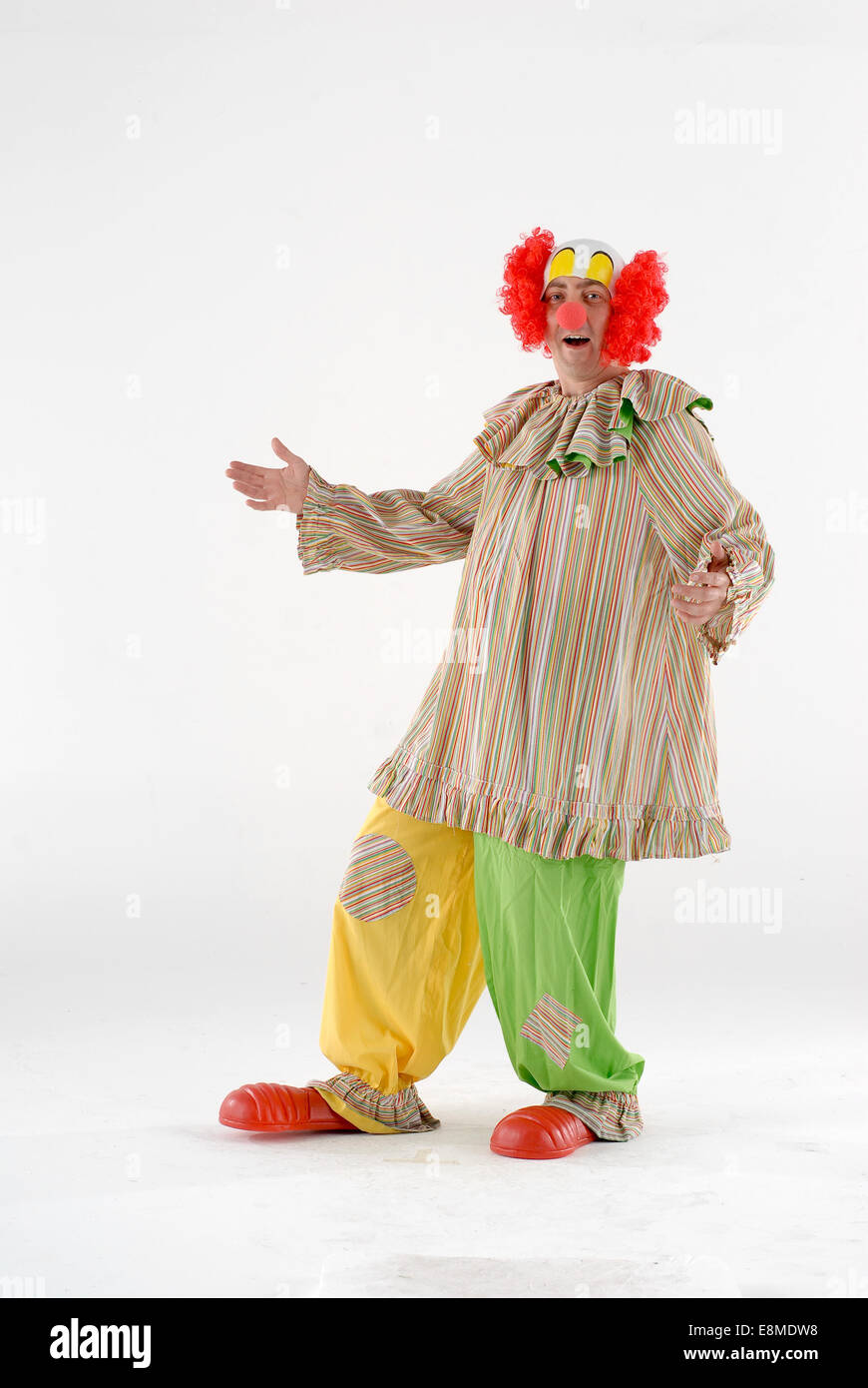 man dressed in fancy dress comedy costume in a circus clown outfit with funny wig baggy clothes giant shoes u0026 red nose  sc 1 st  Alamy & man dressed in fancy dress comedy costume in a circus clown outfit ...