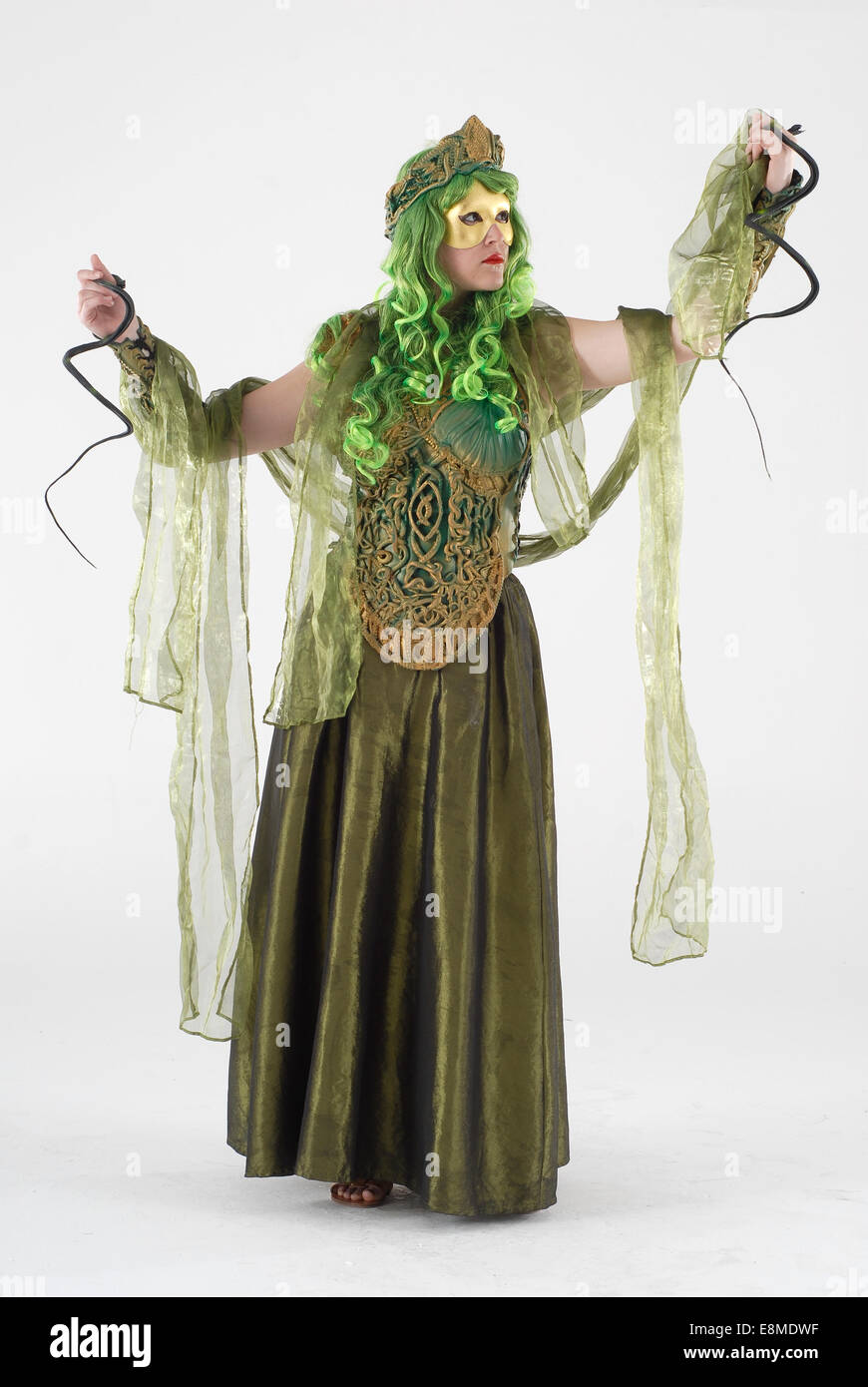 Woman in fancy dress comedy costume as Medusa mythological character, suitable for pantomime / play Stock Photo
