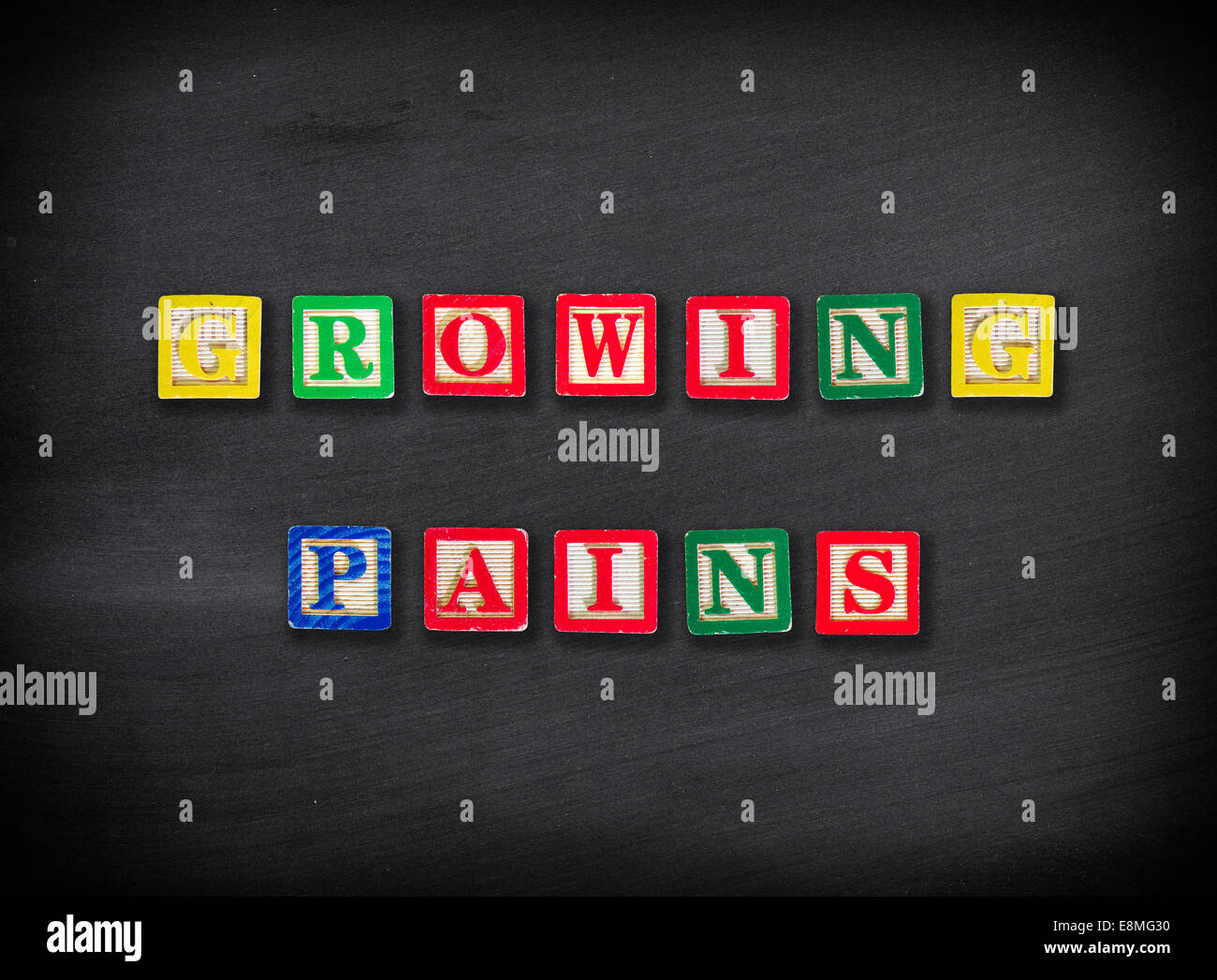 Growing pains concept - Stock Image