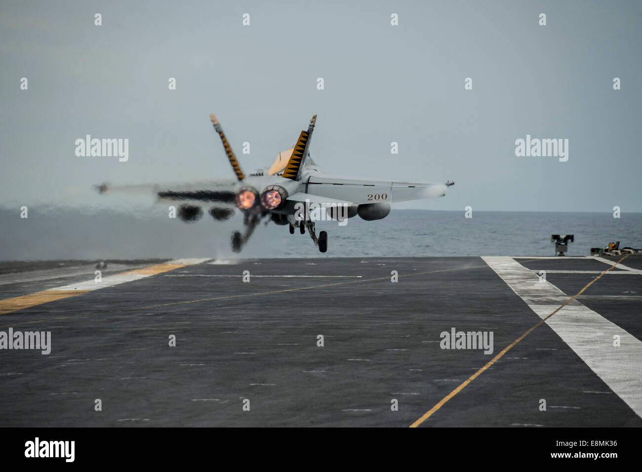 South China Sea, October 24, 2013 - An F/A-18E Super Hornet takes off from the flight deck of the U.S. Navy's - Stock Image