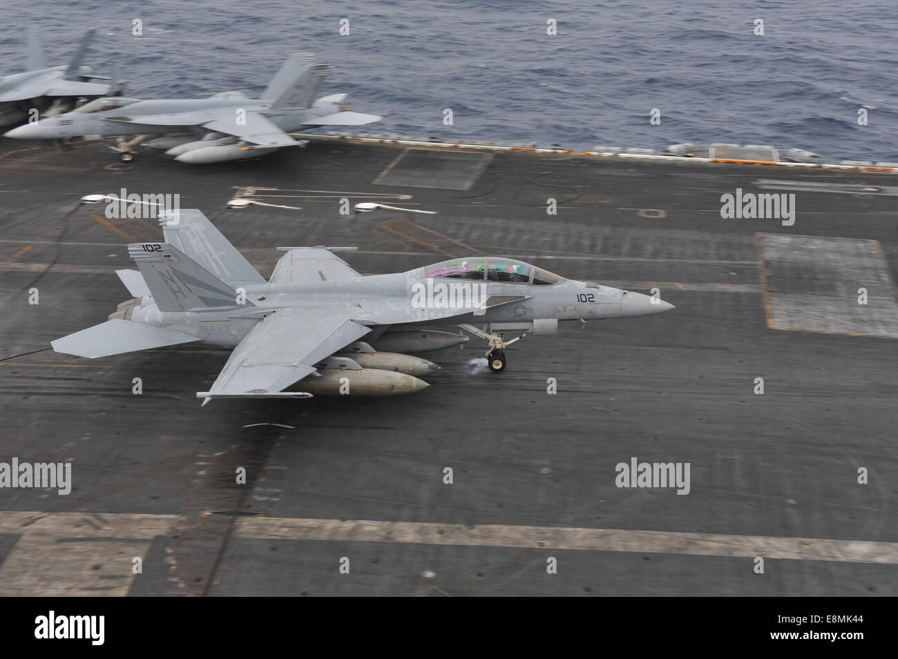 South China Sea, November 23, 2013 - An F/A-18F Super Hornet lands on the flight deck aboard the aircraft carrier - Stock Image