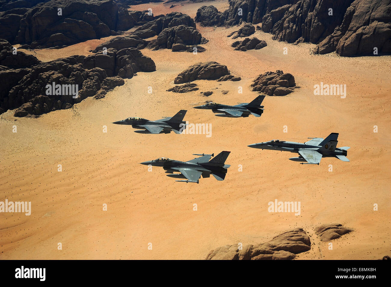 May 13, 2014 - F-16 Fighting Falcons from the U.S. and Royal Jordanian Air Forces, along with an F-18 Hornet from - Stock Image