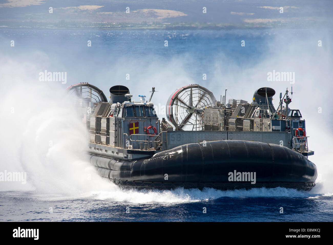 Pacific Ocean, July 23, 2014 - A landing craft air cushion prepares to embark the well deck of the amphibious dock - Stock Image