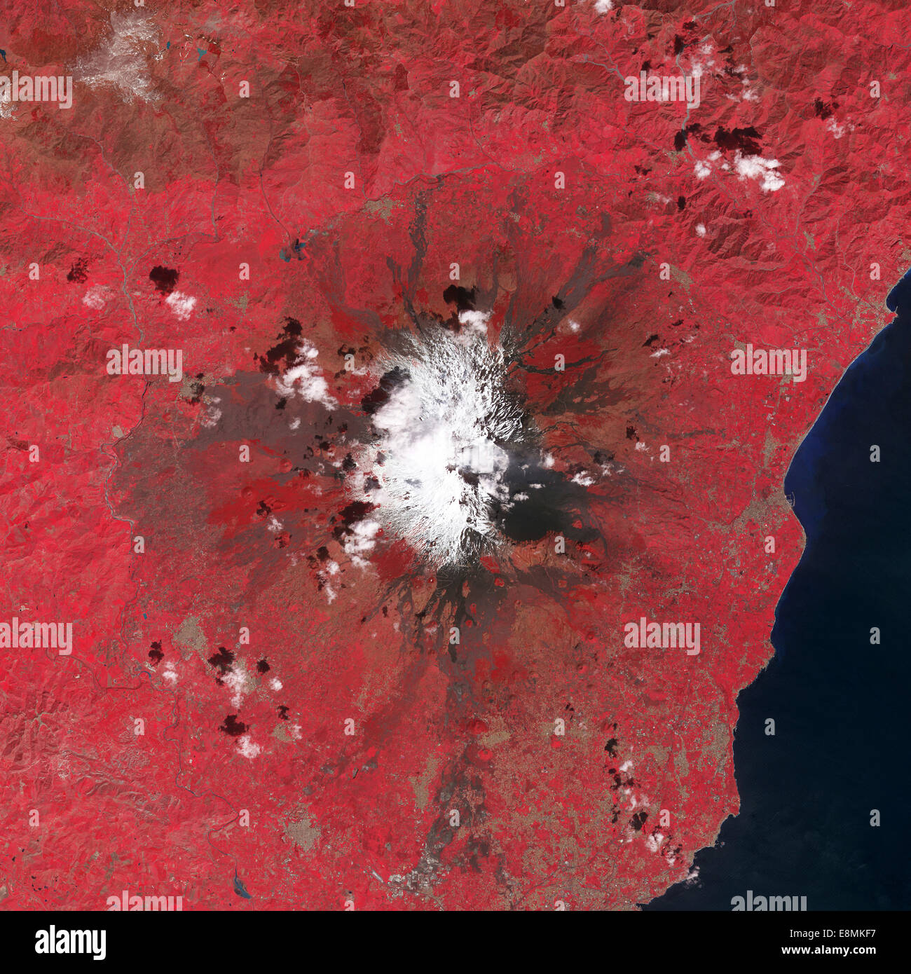 March 31, 2013 - This false-color satellite image shows several vents near the summit of Mount Etna emitting plumes - Stock Image