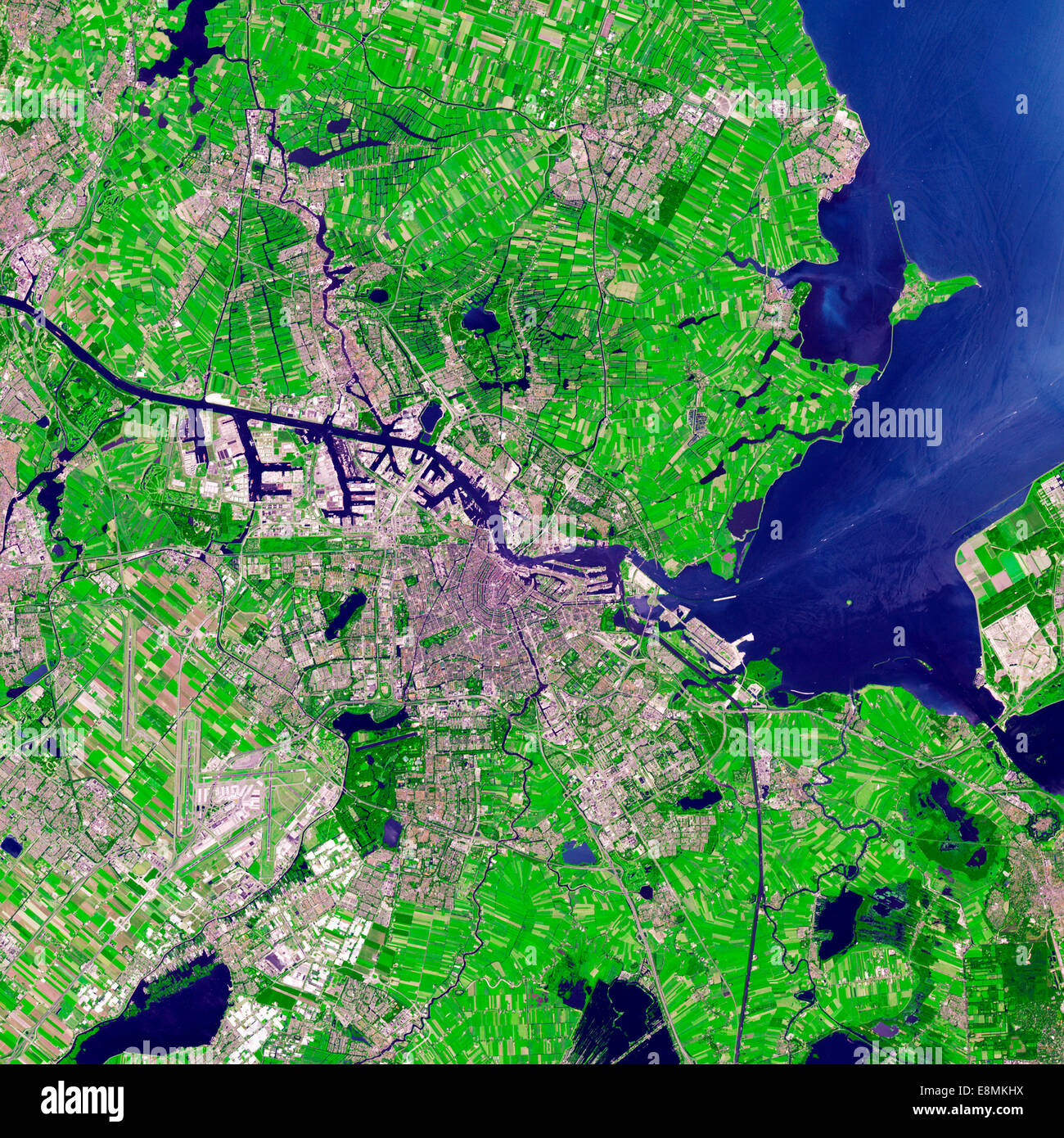 July 24, 2012 - Satellite view of Amsterdam, Netherlands. Urbanized areas appear in shades of gray; vegetation is - Stock Image