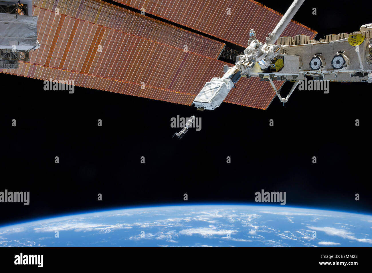 February 11, 2014 - The Small Satellite Orbital Deployer (SSOD), in the grasp of the Kibo laboratory robotic arm, - Stock Image