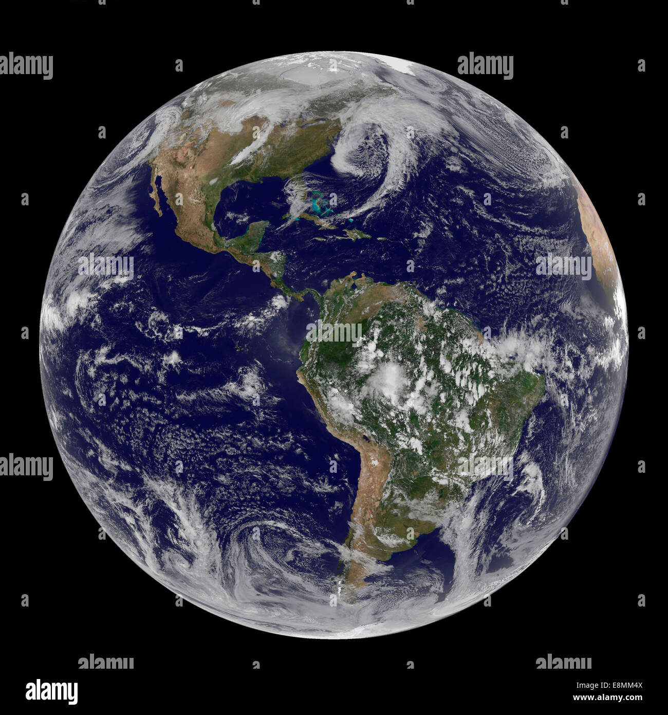 March 31, 2014 - Satellite view of full Earth showing low pressure systems in the eastern Pacific Ocean, over the - Stock Image