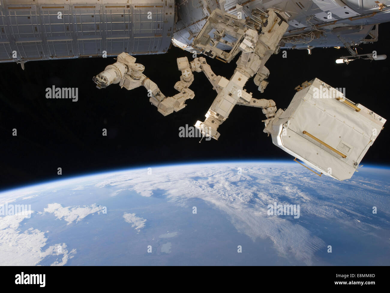 April 18, 2011 - The Canadian-built Dextre, also known as the Special Purpose Dextrous Manipulator (SPDM), backdropped - Stock Image