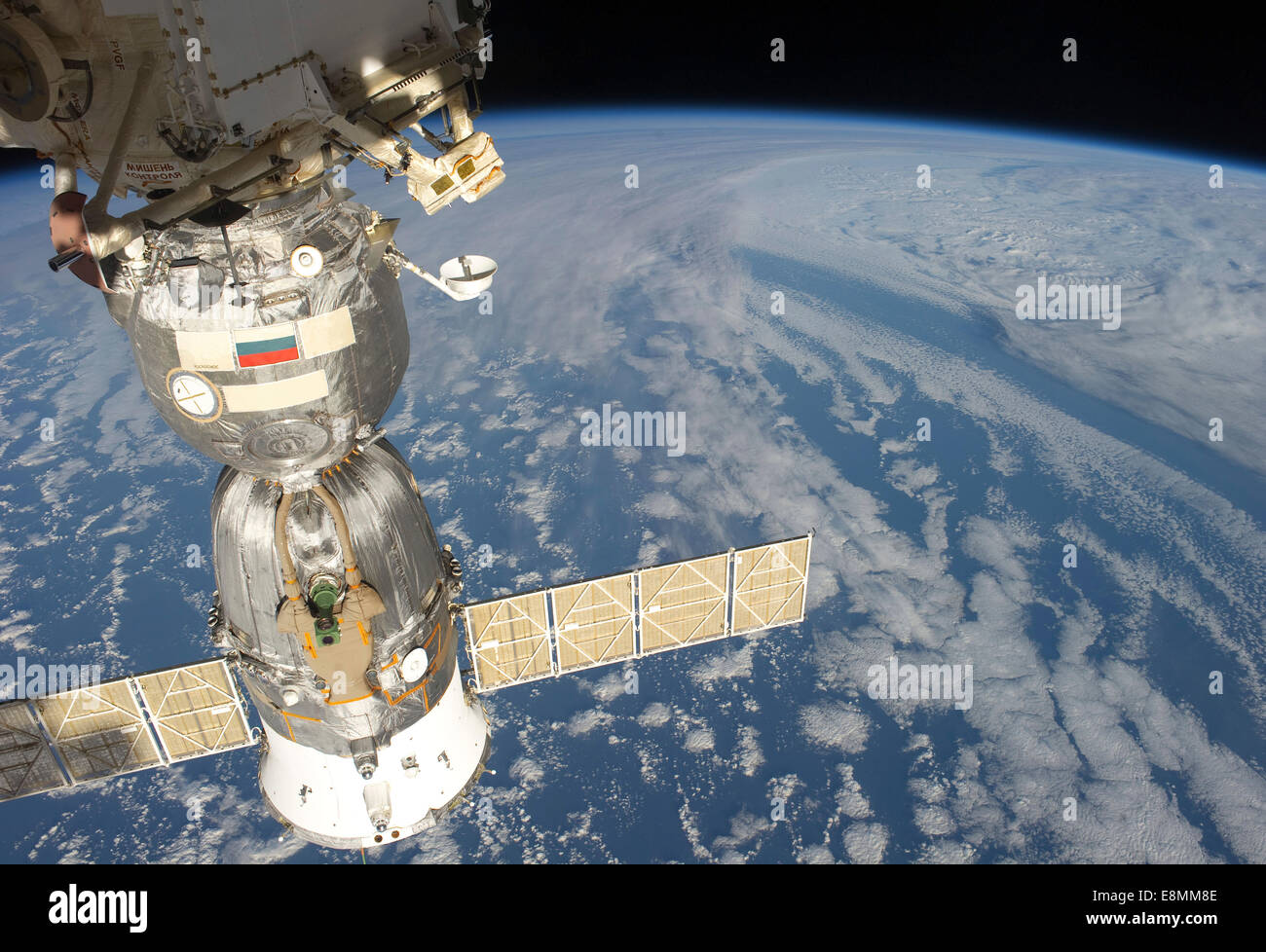 April 22, 2011 - A docked Russian Soyuz spacecraft backdropped by a blue and white part of Earth. - Stock Image