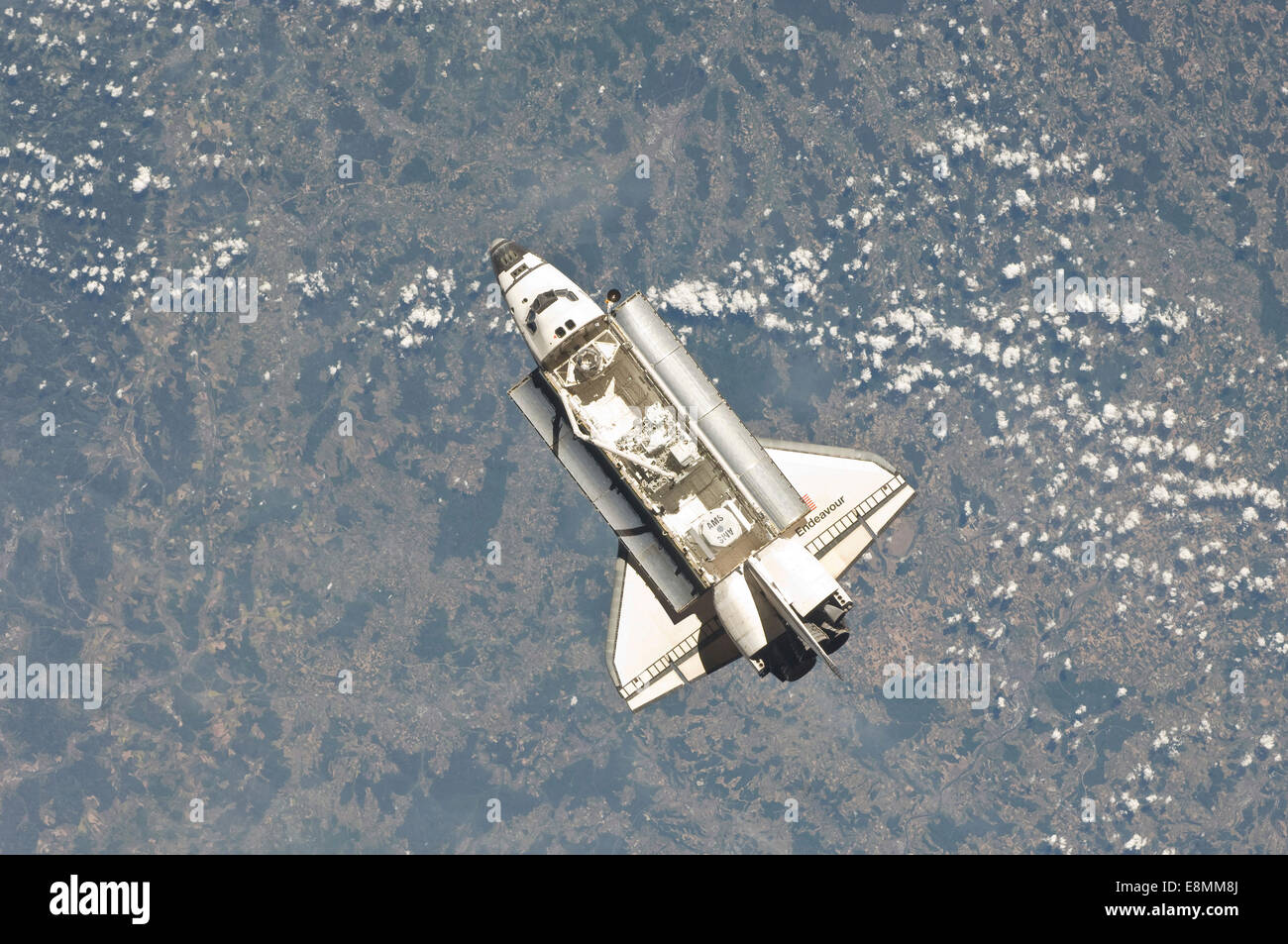 May 18, 2011 - Space shuttle Endeavour backdropped by a colorful Earth. - Stock Image