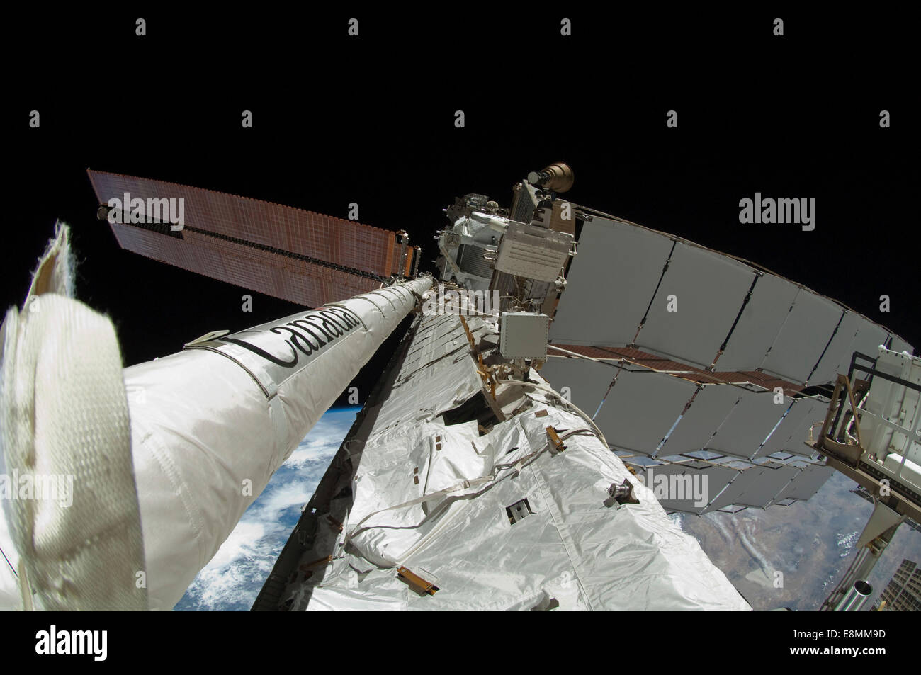 May 27, 2011 - Fish-eye lens view of the newly-attached 50-foot-long Enhanced International Space Station Boom Assembly. - Stock Image