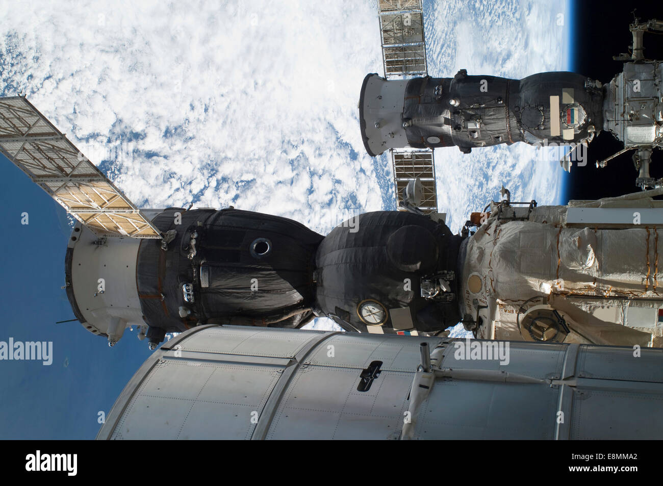 July 12, 2011 - A Russian Soyuz (foreground), and a Russian Progress supply ship (background), are docked to the - Stock Image