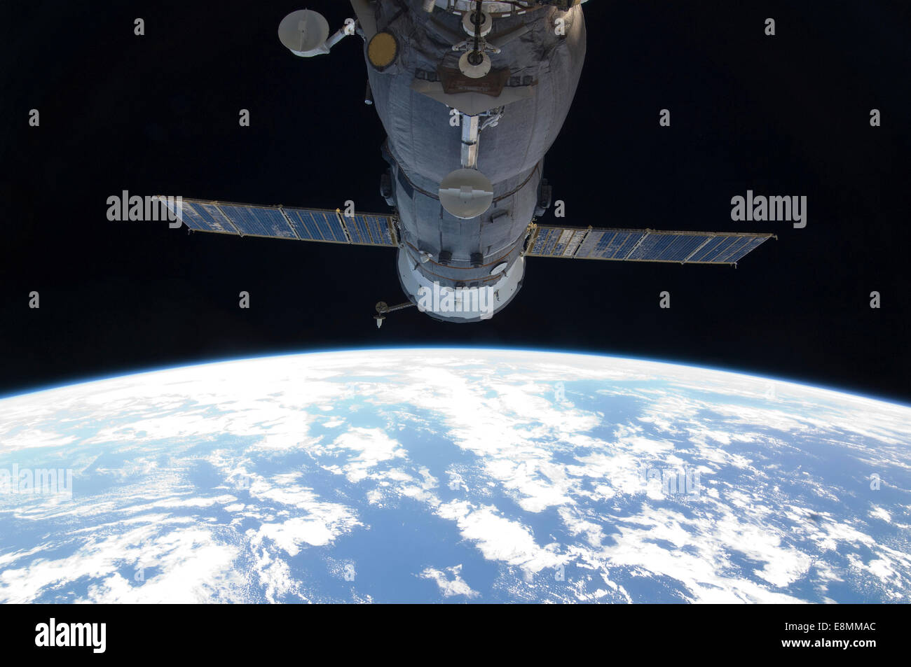 September 16, 2011 - A docked Russian Soyuz spacecraft backdropped by Earth's horizon and the blackness of space. - Stock Image