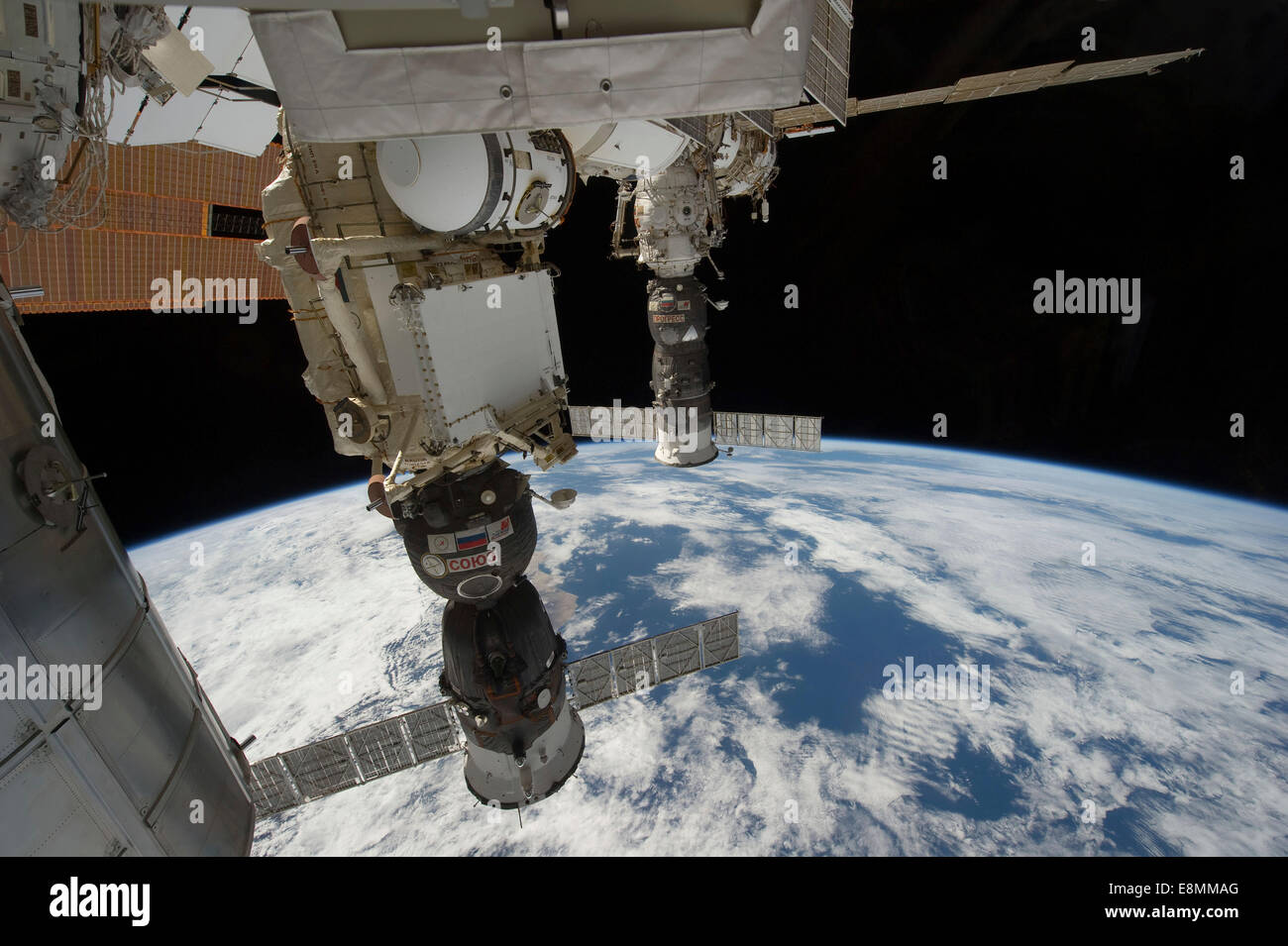 December 31, 2011 - A Russian Soyuz (near foreground) is docked to Rassvet, also known as the Mini-Research Module - Stock Image