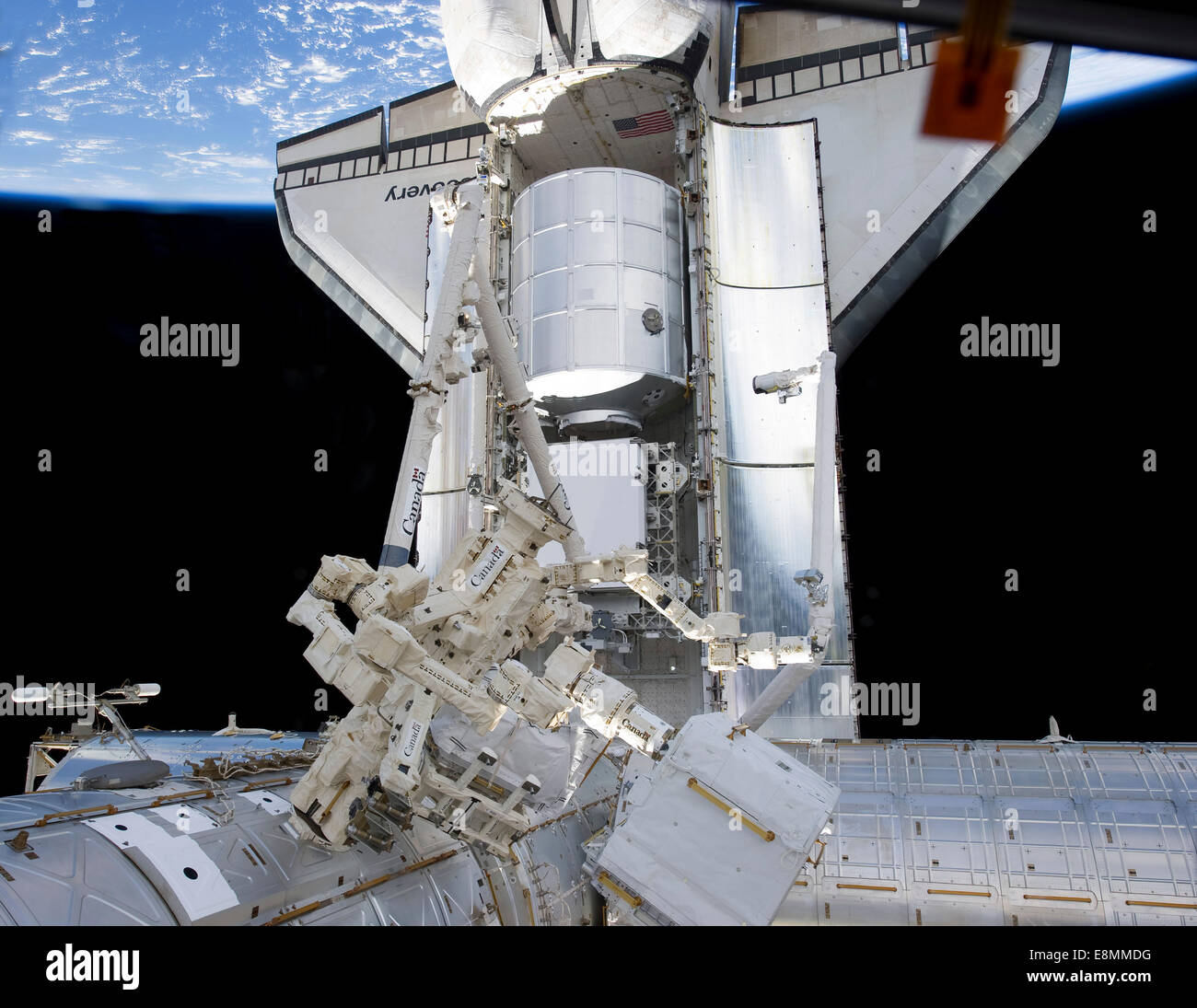February 26, 2011 - Space shuttle Discovery and the Canadian-built Dextre, also known as the Special Purpose Dextrous - Stock Image