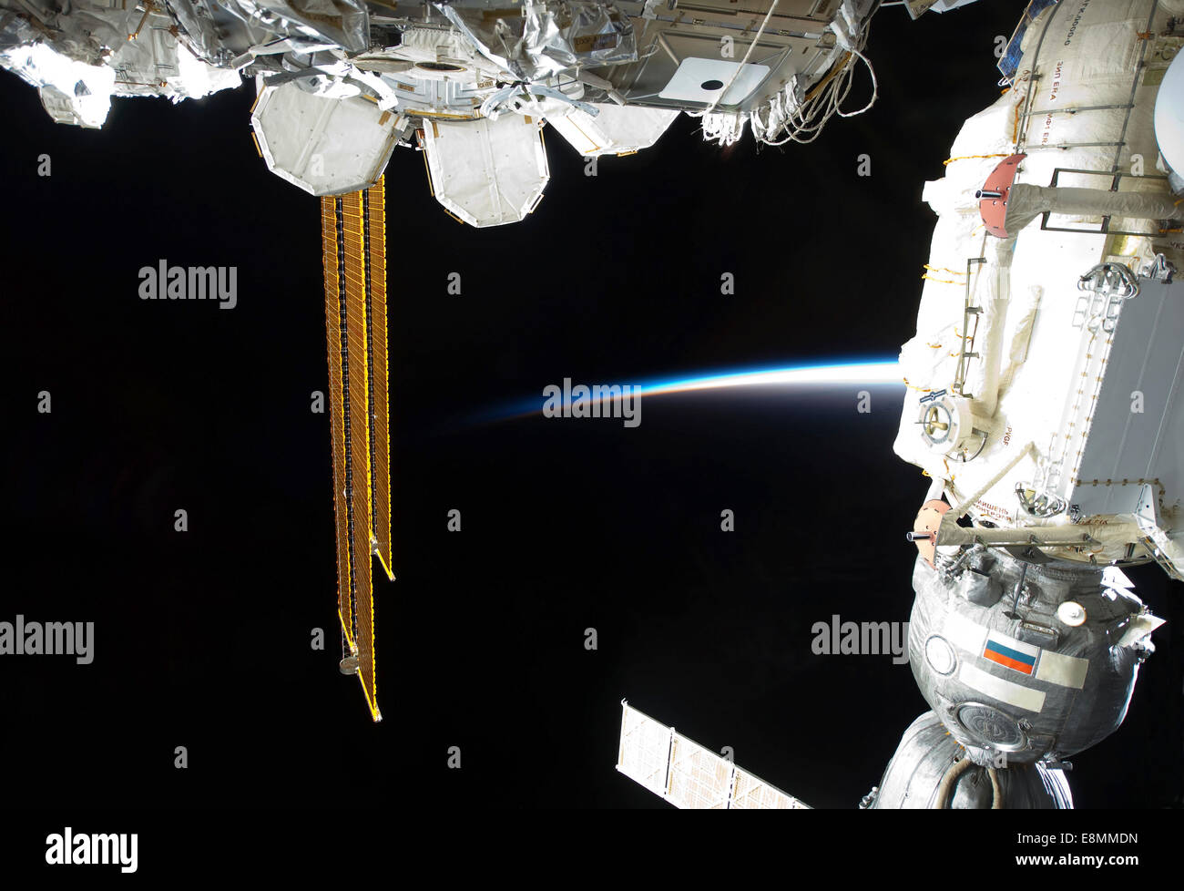 March 1, 2011 - View of a docked Russian Soyuz spacecraft (right), a portion of the International Space Station's - Stock Image