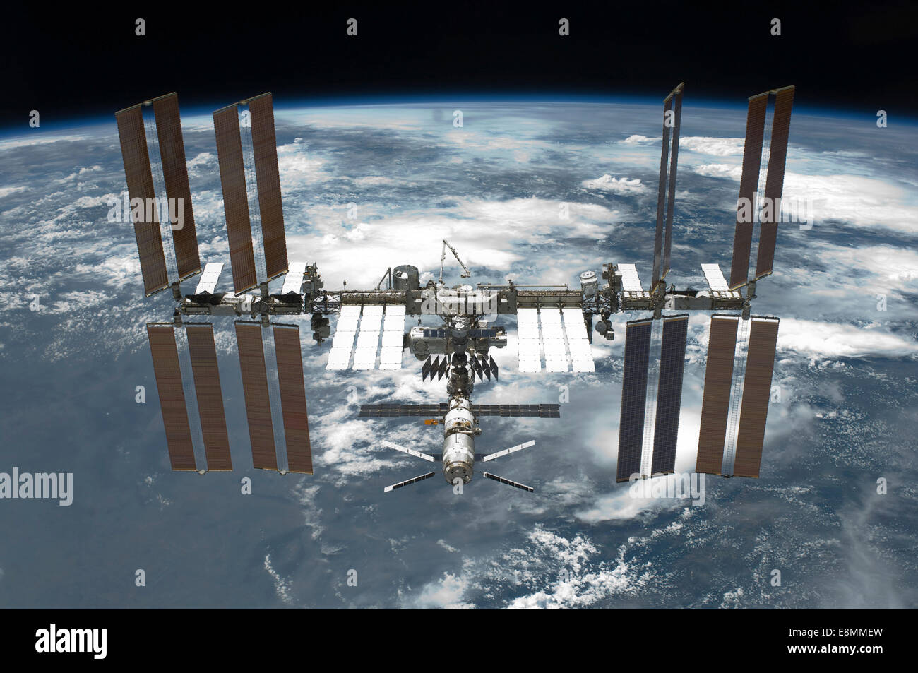 May 29, 2011 - The International Space Station backdropped by a blue and white Earth. - Stock Image