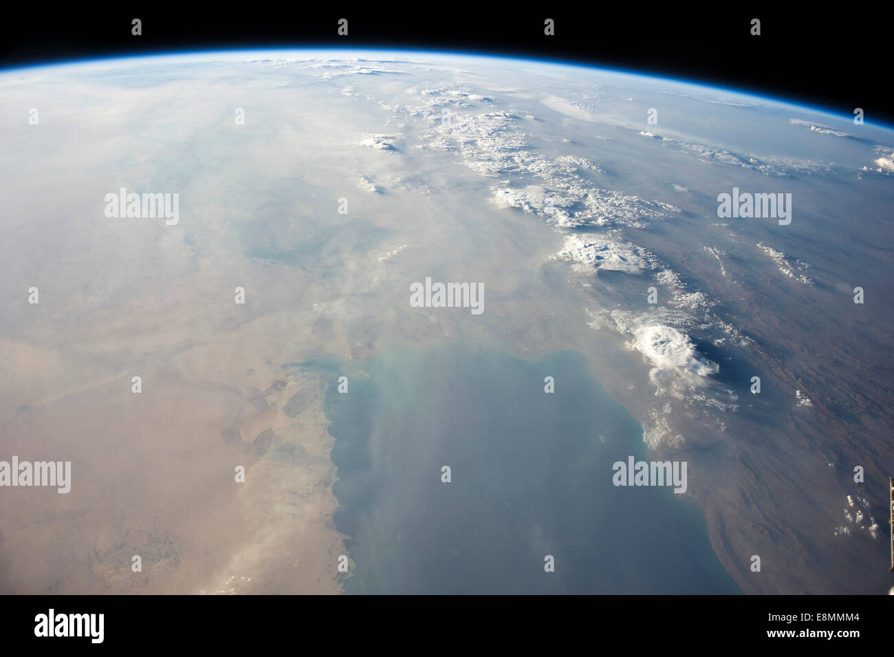 View from space showing the tropical blue waters of the Persian Gulf and then the dust-filled skies as a major dust - Stock Image