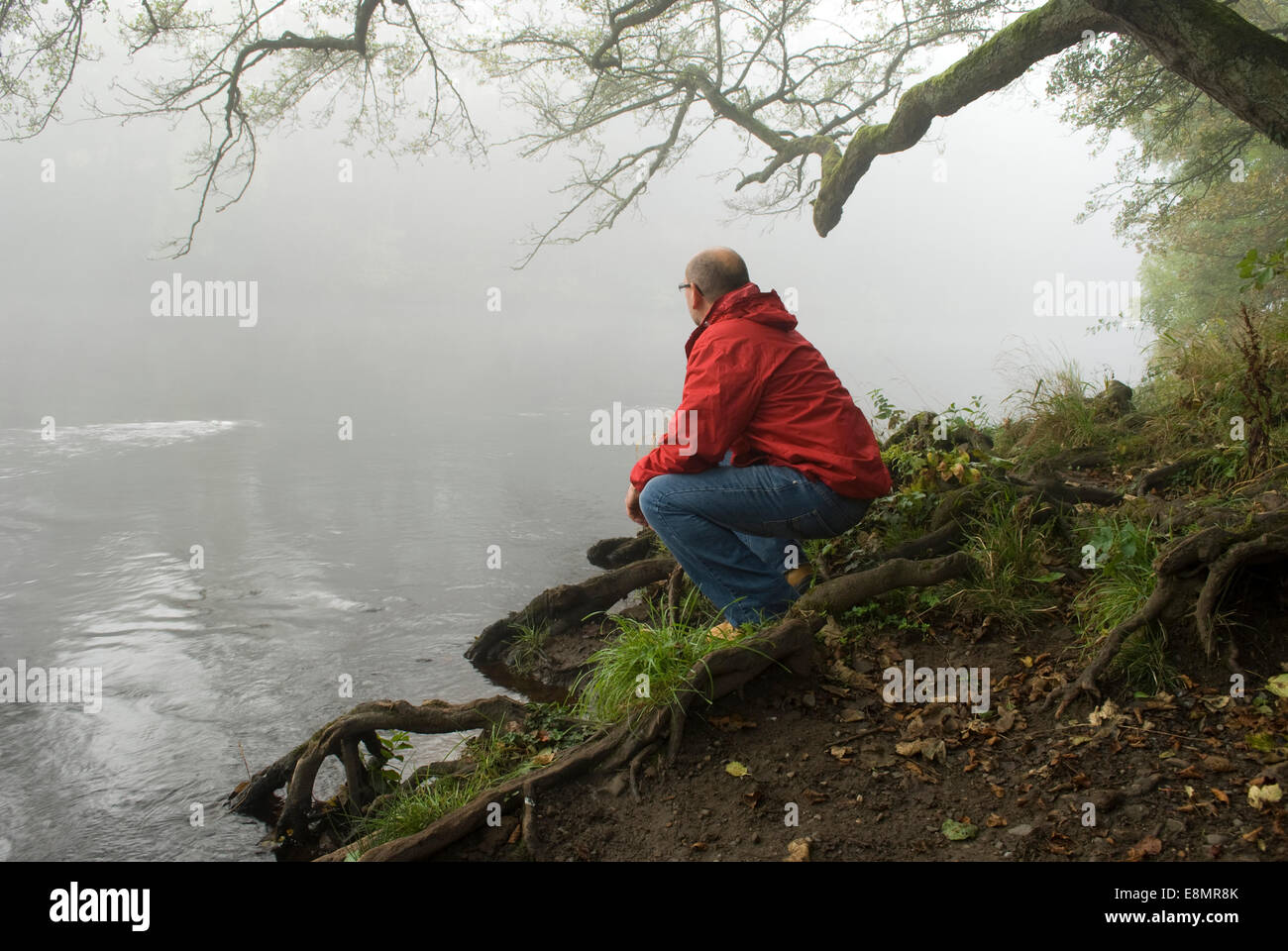 Gainford, County Durham, UK. 11th October 2014. A man looks out at the mist and fog along the upper reaches of the - Stock Image