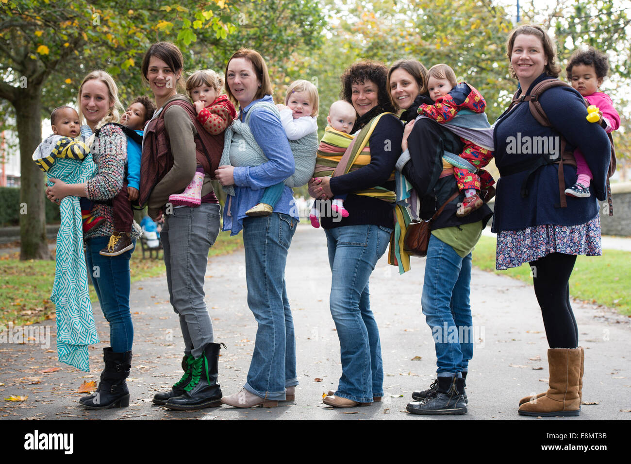 Aberystwyth Wales UK, Saturday 11 October 2014 A group of mothers with their young children held close in slings - Stock Image