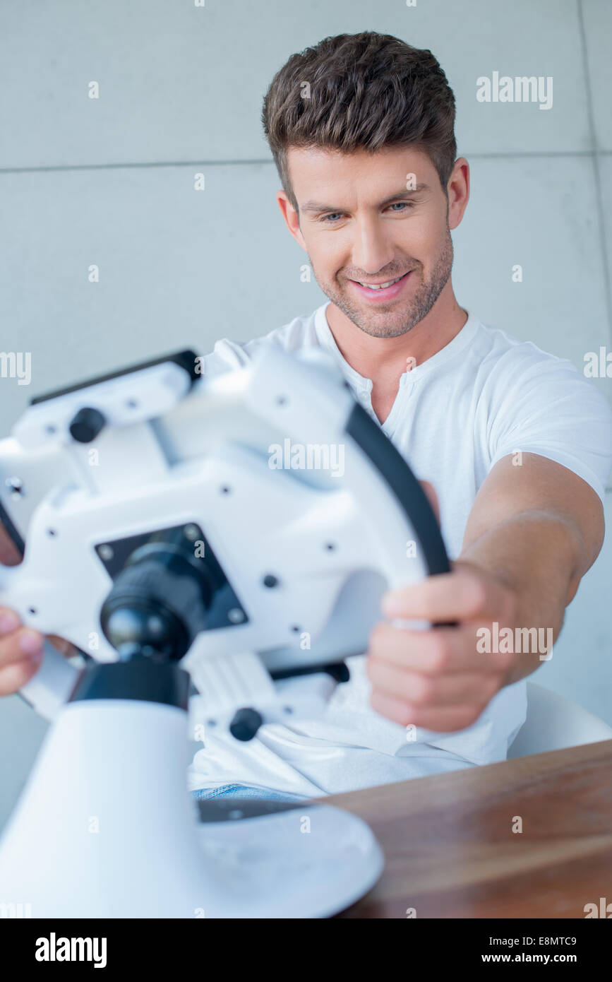 Handsome Middle Age Man Playing Cool Gadget - Stock Image