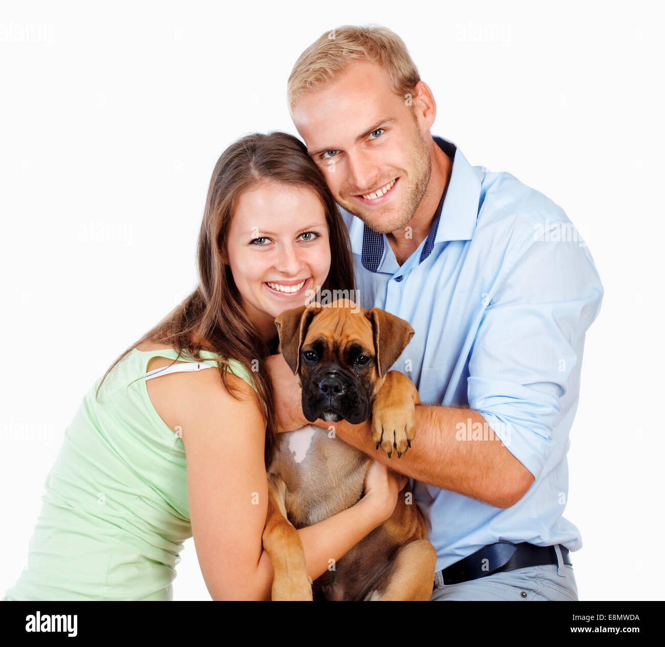 Portrait of a Happy Young Couple with a Dog. Stock Photo