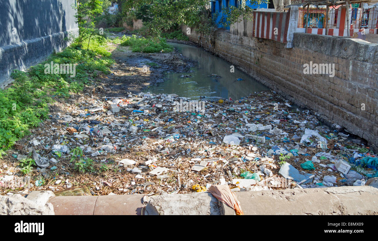 INDIA POLLUTED A STINKING STREAM OR OPEN SEWER LOADED WITH RUBBISH - Stock Image