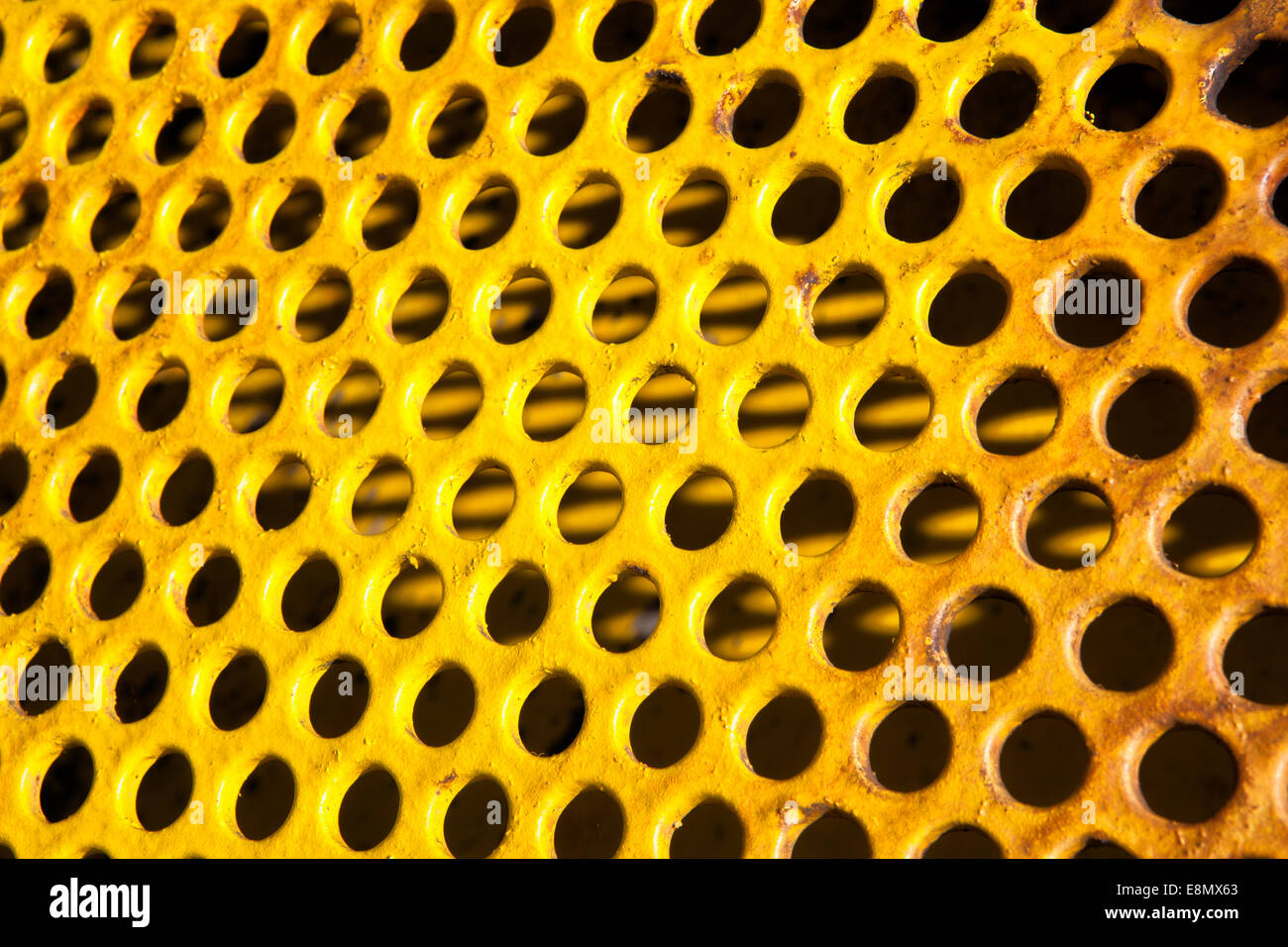 old perforated metal plate - Stock Image