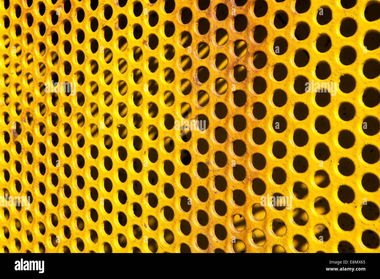 old perforated metal plate, - Stock Image