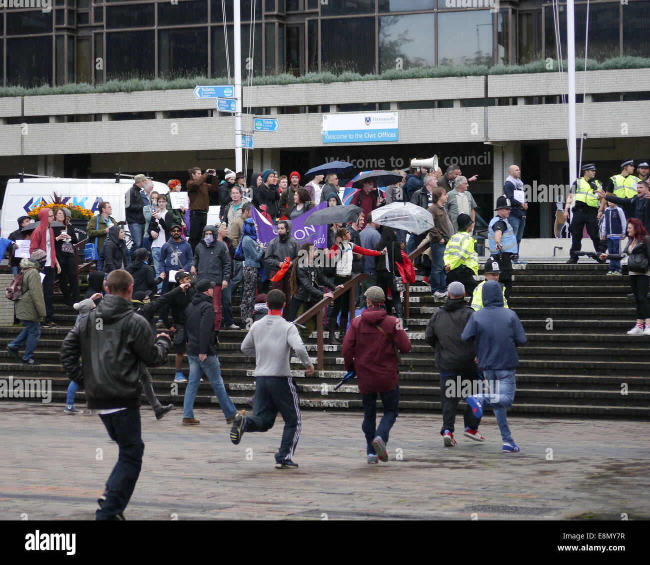 Members of the English Defence League break away from the Police in the centre of the Guildhall Square and Run towards - Stock Image