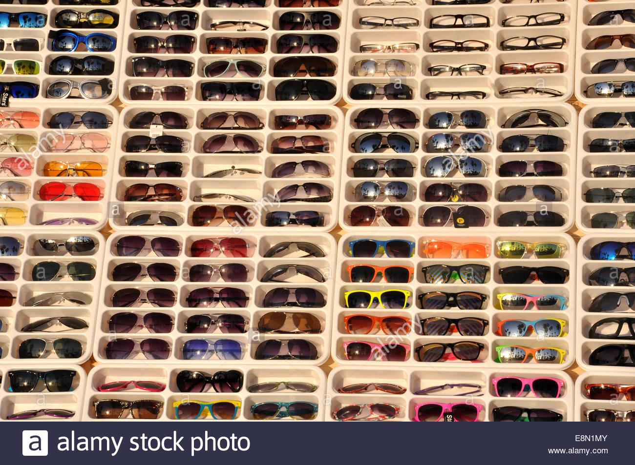 Racks of Sunglasses on sale at Venice Beach in California, USA Stock Photo