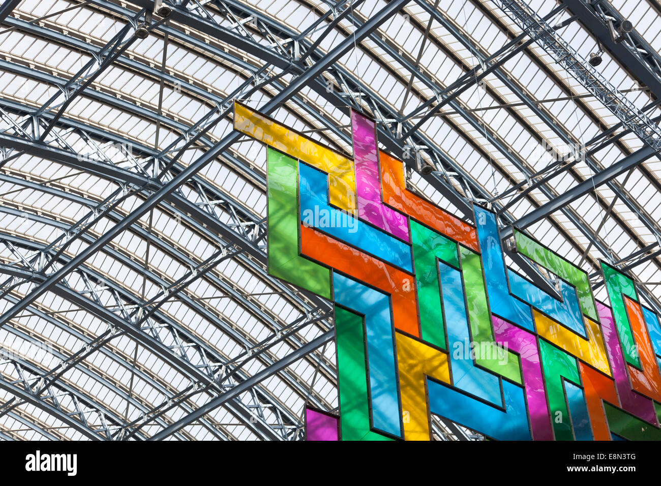 Chromolocomotion by David Batchelor hanging at St. Pancras Internation Station in London, April 2014 - Stock Image